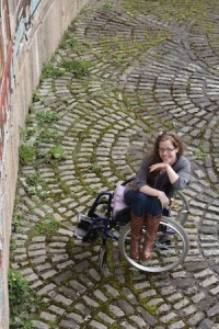 grace in wheelchair in silver dress