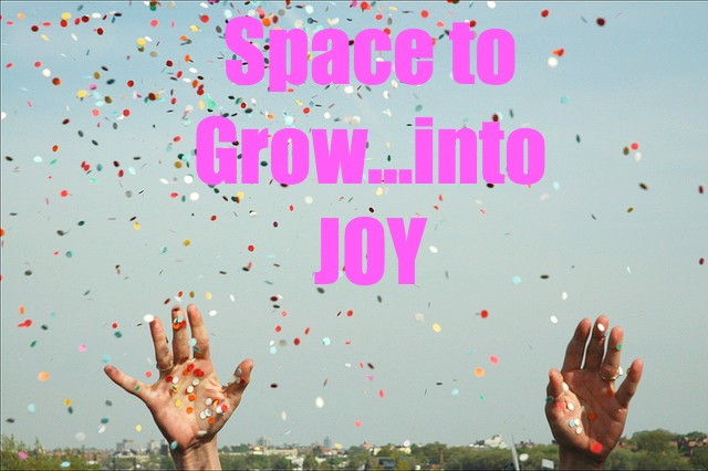 Space to Grow…into JOY: hands raised in air with confetti coming down