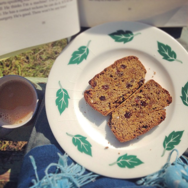 gluten free vegan bread with a cup of tea and a book