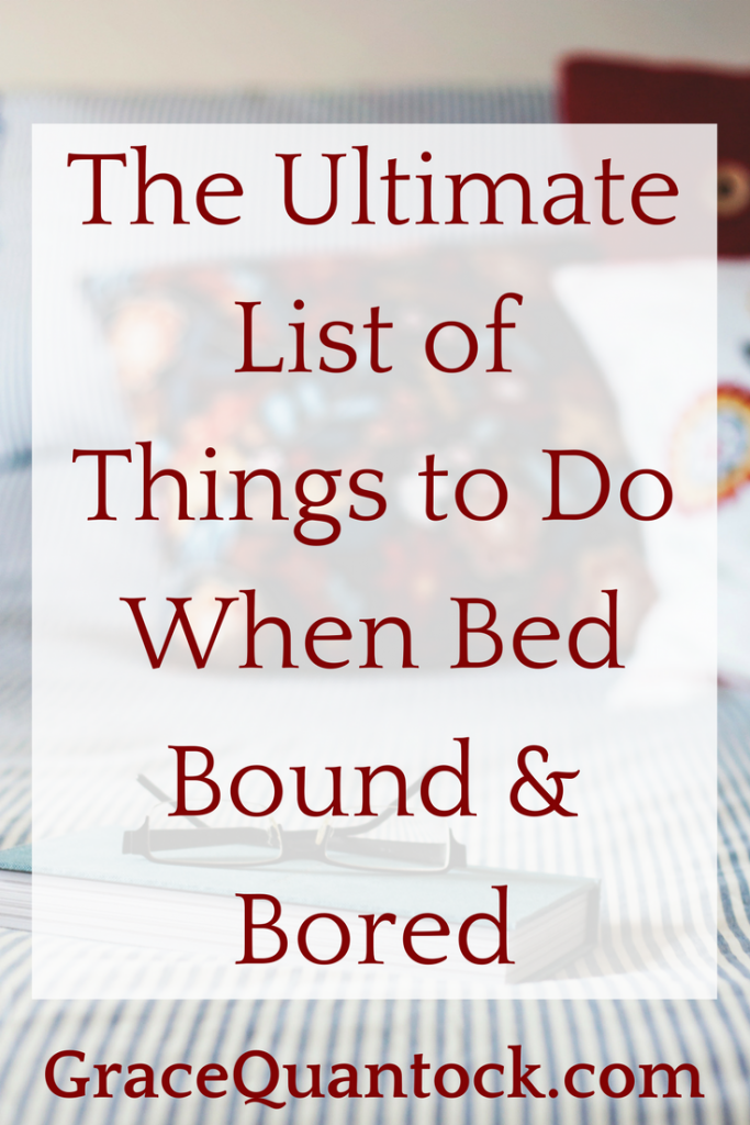 The ultimate list of things to do when bed bound and bored. Red text on a white square. Back ground is photograph of a bed with a blue and white striped quilt and embroidered red and white pillows against the headboard.