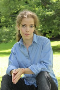 Grace Quantock in blue shirt in forest