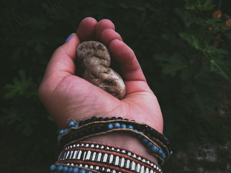 Hand holding stone memento - 3 Swift Ways to Support Habit Changing & Transformation Part 1