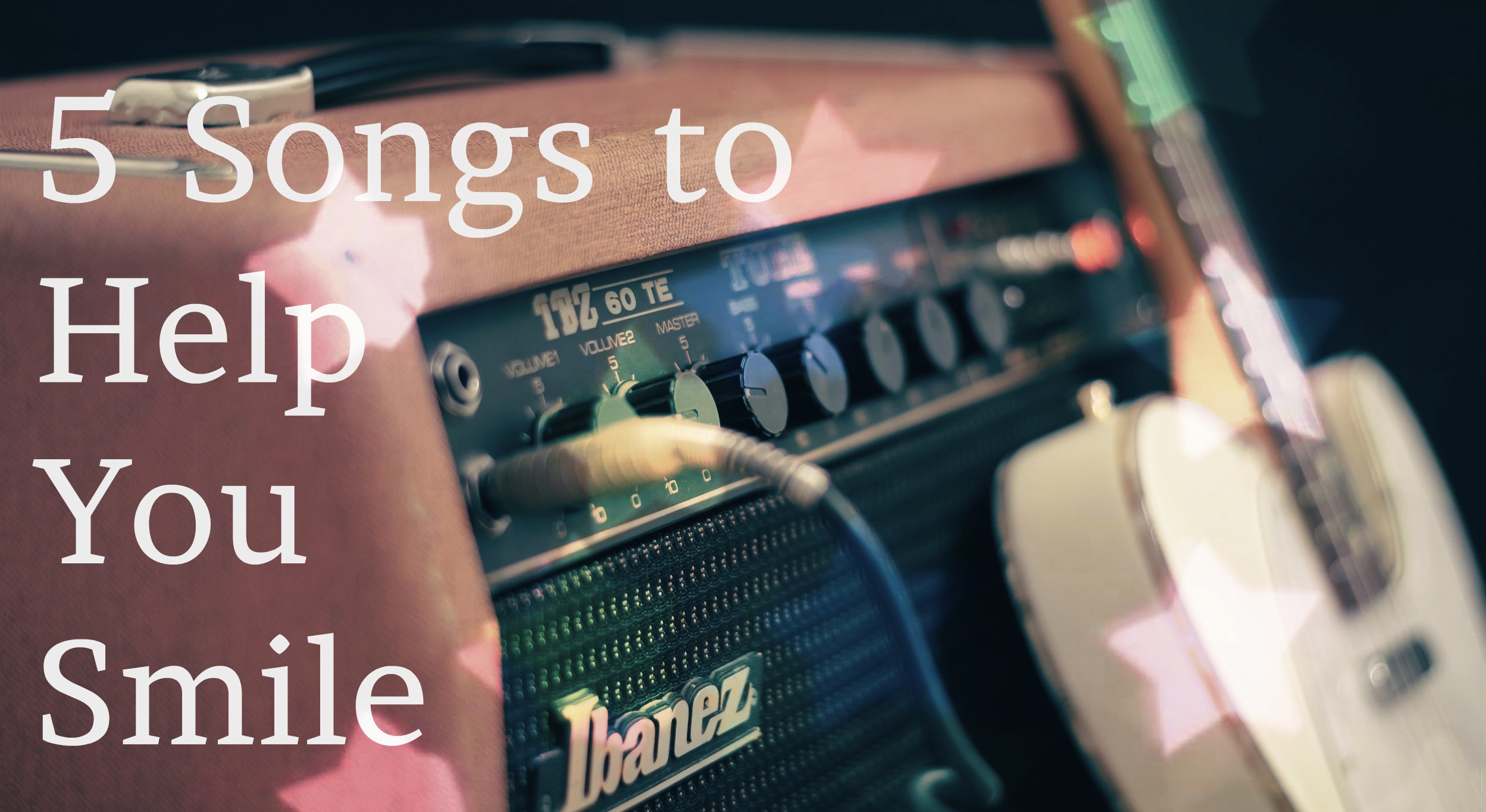 5 songs to help you smile - white text over image of pink amplifier and guitar with heart shaped star bokeh