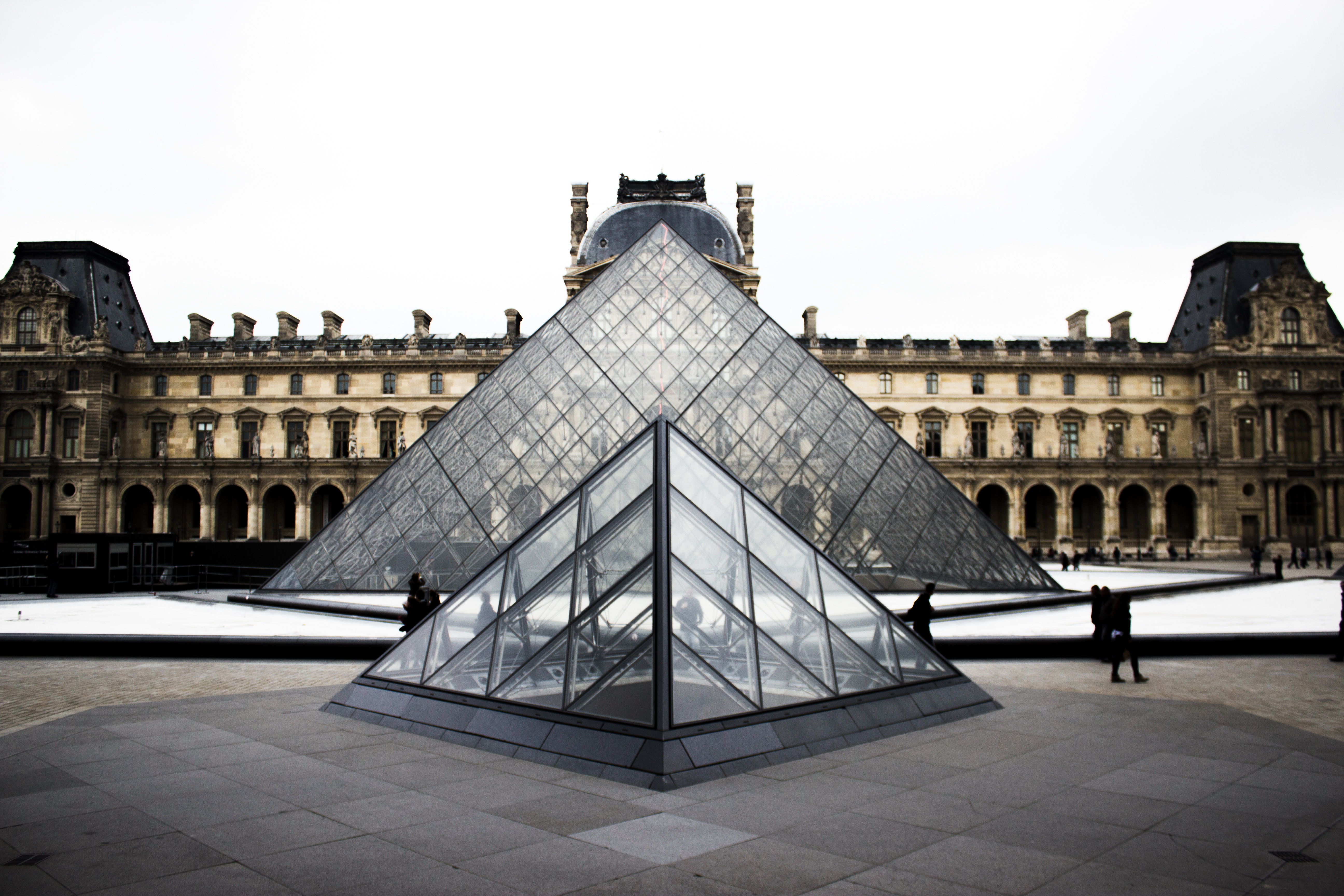 louvre paris on overcast day