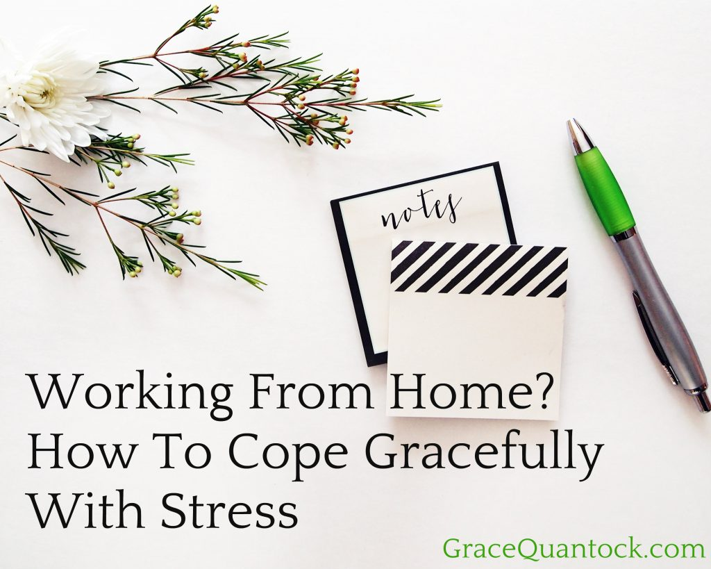 A desk with flowers, notepad and green pen, text: Coping With Stress Working From Home