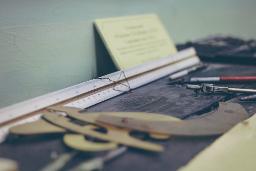 drafting tools on an old desk