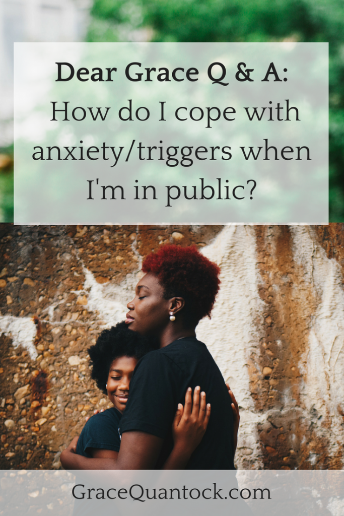 Dear Grace Q & A: How do I cope with anxiety/triggers when I'm in public? Text above out of focus photo of forest. Below photograph of older black woman with red hair hugging a younger black woman to her.