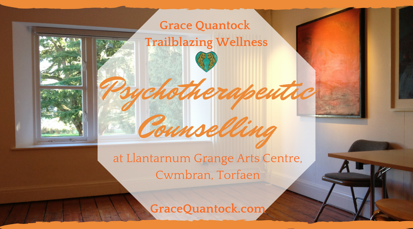 Grace Quantock Trailblazing Wellness Psychotherapeutic Counselling at Llantarnim Grange Arts Centre, Cwmbran, Torfaen GraceQuantock.com text in orange over a white octagon over a photograph of a therapy room showing a chair and a window with cedars beyond.