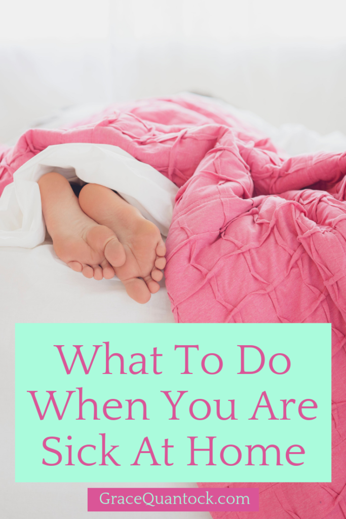 What to do when you are sick at home. Pink text on a mint green square, over a photo of a person's feet, sticking out of a ruffled pink duvet on a bed.