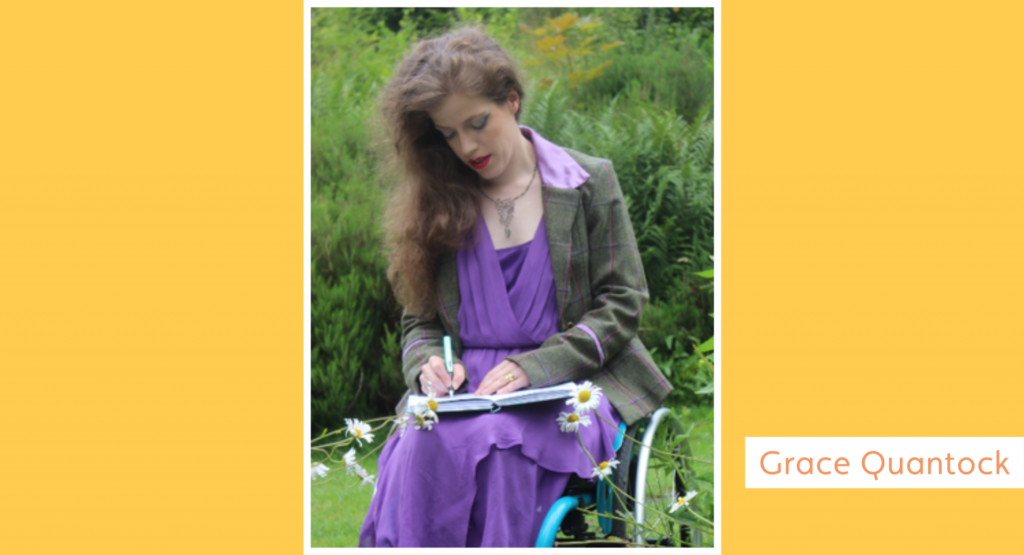 Photograph of Grace sitting in her wheelchair, journalling with a green fountain pen. Her long brunette hair is down over one shoulder and she has a purple dress, green tweed jacket and red lipstick.